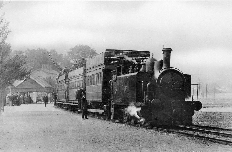 SWANSEA AND MUMBLES TRAMWAY - A train pauses at Oystermouth Station. I am unable to find any information on the locomotives except that three were called CRUMLYN, SWANSEA and HAMPSHIRE.<br /> The Swansea and Mumbles Railway was the world's first passenger railway service. Originally built under an Act of Parliament of 1804 to move limestone from the quarries of Mumbles to Swansea, it carried the world's first fare-paying railway passengers on March 25th, 1807. It later moved from horse power to steam locomotion in 1896, and finally converted to electric trams in 1929, before closing in January 1960, in favour of motor buses. The line was 5.5 miles long and converted to standard gauge in 1855. At the time of the railway's closure, it had been the world's longest serving railway.