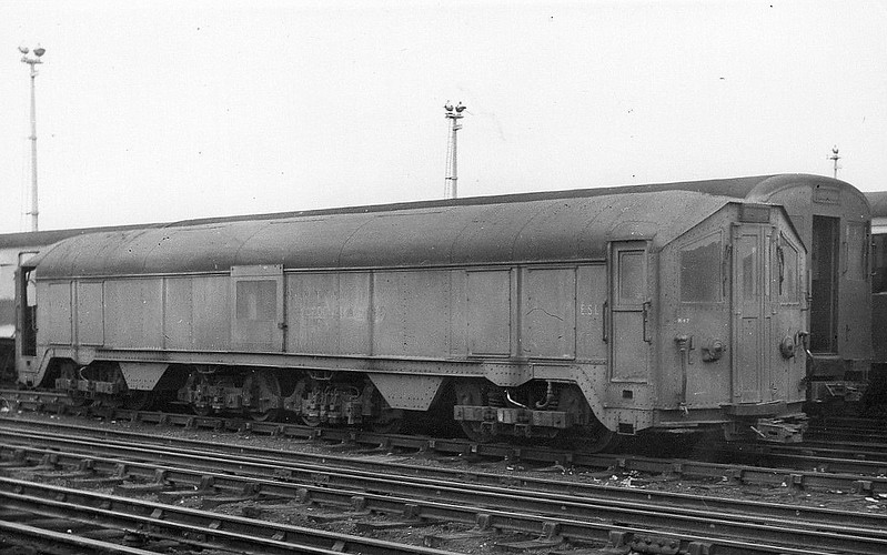LONDON TRANSPORT - ESL 113 - De-Icing (Sleet) Locomotive - built between 1938 and 1941 by placing two 1903-vintage Central London Railway locomotives back-to-back, cutting off one end and building a new central section with 2 de-icing bogies - redundant when de-icing equipment was fitted to service trains - 1972 ESL 100-112 converted to RHTT duties - 07/80 ESL 113 scrapped - it was formed from CLR locos Nos.3962 and 3969 - seen here at Neasden in 1952.