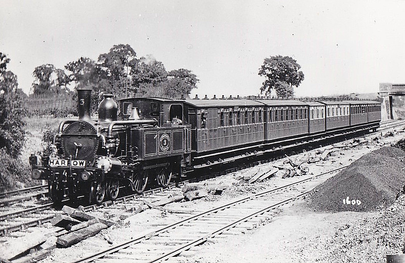 METROPOLITAN RAILWAY - 3 - Class A 4-4-0T - built 1864 by Beyer Peacock Ltd, Works No.414 - all but 13 withdrawn by 1914 - seen here on Harrow train.