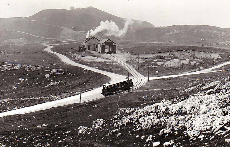 GREAT ORME TRAMWAY - A descending tram departs from Halfway Station whilst, in the background just below Orme Head, can be seen ascending and descending  vehicles on the upper section.