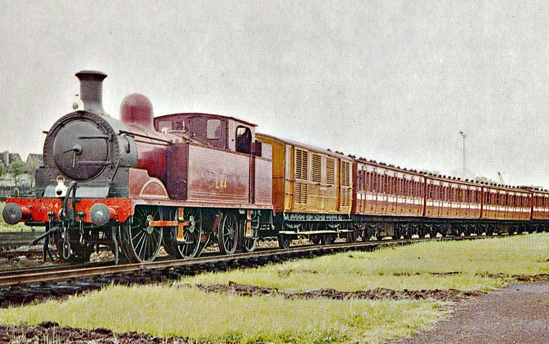 LONDON TRANSPORT - L44 - Metropolitan Class E 0-4-4T - built 1896 by Neasden Works as MR No.79 - renumbered No.1 after original loco was destroyed in an accident - 1935 to LT No.L44 - 1961 worked last LT steam hauled passenger train - 1965 withdrawn - preserved - seen here on a vintage train at Neasden, 1963.