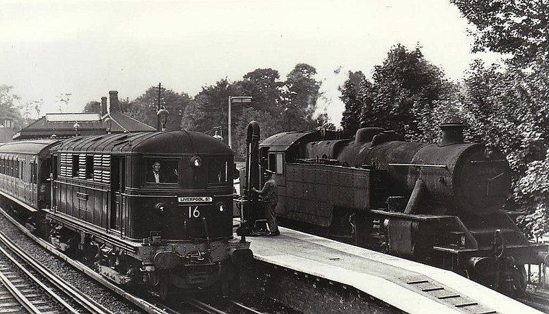 LONDON TRANSPORT - 16 OLIVER GOLDSMITH - built 1923 by Metropolitan Vickers Ltd - 1962 withdrawn on completion of electrification to Amersham - seen here at Rickmansworth, exchange point between electric and steam, with 42134, 09/61.