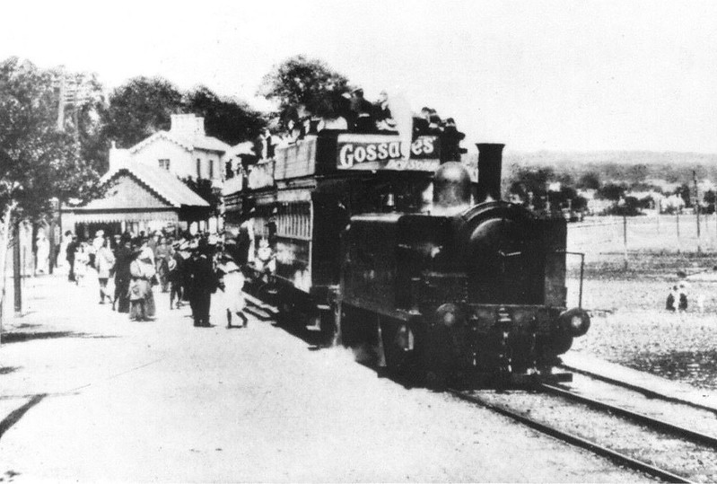 SWANSEA AND MUMBLES TRAMWAY - A packed train stops at Oystermouth Station in about 1900. I am unable to find any information on the locomotives except that three were called CRUMLYN, SWANSEA and HAMPSHIRE.<br /> The Swansea and Mumbles Railway was the world's first passenger railway service. Originally built under an Act of Parliament of 1804 to move limestone from the quarries of Mumbles to Swansea, it carried the world's first fare-paying railway passengers on March 25th, 1807. It later moved from horse power to steam locomotion in 1896, and finally converted to electric trams in 1929, before closing in January 1960, in favour of motor buses. The line was 5.5 miles long and converted to standard gauge in 1855. At the time of the railway's closure, it had been the world's longest serving railway.