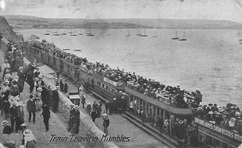 SWANSEA AND MUMBLES TRAMWAY - A packed train composed of a bizarre mixture of stock leaves Mumbles. I am unable to find any information on the locomotives except that three were called CRUMLYN, SWANSEA and HAMPSHIRE. Even 100 years ago, travelling like this couldn't have been considered safe!<br /> The Swansea and Mumbles Railway was the world's first passenger railway service. Originally built under an Act of Parliament of 1804 to move limestone from the quarries of Mumbles to Swansea, it carried the world's first fare-paying railway passengers on March 25th, 1807. It later moved from horse power to steam locomotion in 1896, and finally converted to electric trams in 1929, before closing in January 1960, in favour of motor buses. The line was 5.5 miles long and converted to standard gauge in 1855. At the time of the railway's closure, it had been the world's longest serving railway.