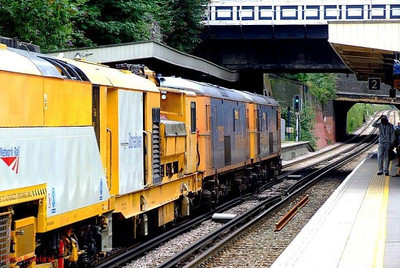 "A departing view of GBRf electro-diesels 73209 ""Alison"" + 73205 ""Jeanette"" as they double-head a stoneblower through Denmark Hill; this is the late running 6U27 Ashford-Alton move. 11th August 2008."