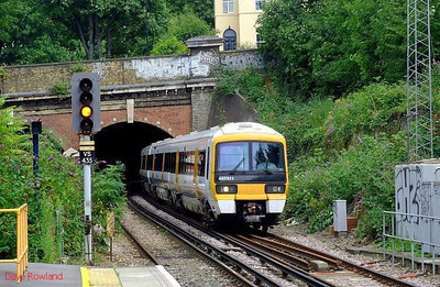 South Eastern 465 921 (with 466 009 still in Grove tunnel) runs into Denmark Hill with 2K78, the 12.45 Faversham-Victoria service. 11th August 2008.