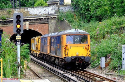 "GBRf electro-diesels 73209 ""Alison"" + 73205 ""Jeanette"" double-head a stoneblower through Denmark Hill; this is the late running 6U27 Ashford-Alton move. 11th August 2008."