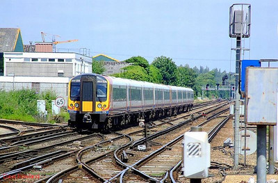 SWT 444 030 (at the rear) + 444 041 pass Eastleigh with 1W40, the 11.03 Weymouth-Waterloo. 28th June 2008.