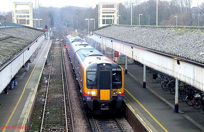 SWT 450 032 is seen from the station footbridge at Fareham as it arrives with 2E21, the 09.44 Southampton Central-Portsmouth & Southsea stopping service; note the towers in position for the new footbridge. 23rd December 2008.