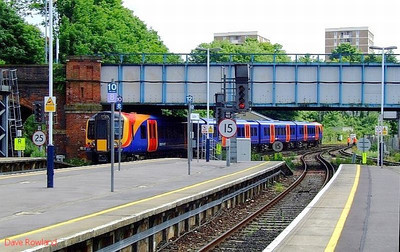 SWT 450 085 is seen departing Guildford with 2P39, the 13.45 Waterloo-Portsmouth Harbour stopping service. 22nd May 2008.