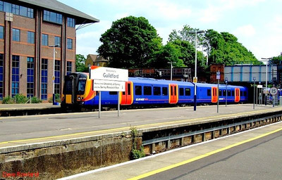 SWT 450 084 departs Guildford with 1P41, the 14.00 Waterloo-Portsmouth Harbour fast service; 450 127 forms the front half of the train. 22nd May 2008.
