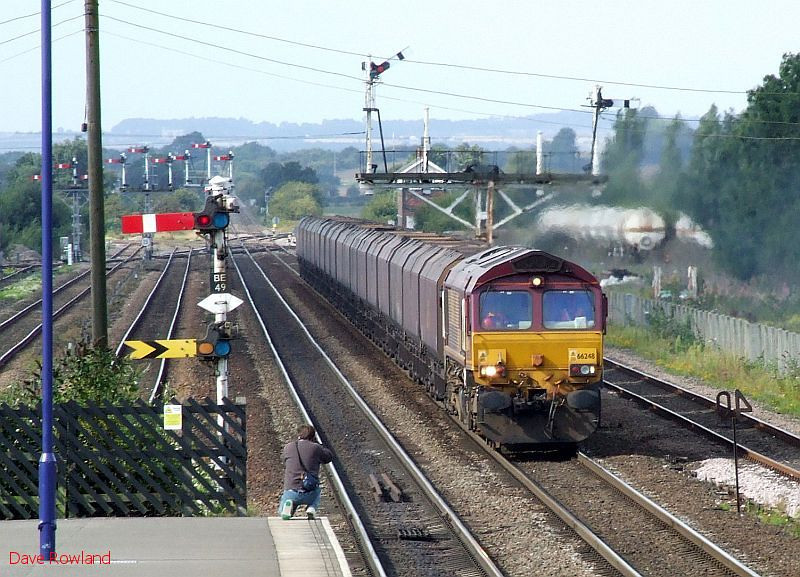 EWS 66248 approaches Barnetby with an eastbound rake of empty EWS coal hoppers. 20th August 2009.