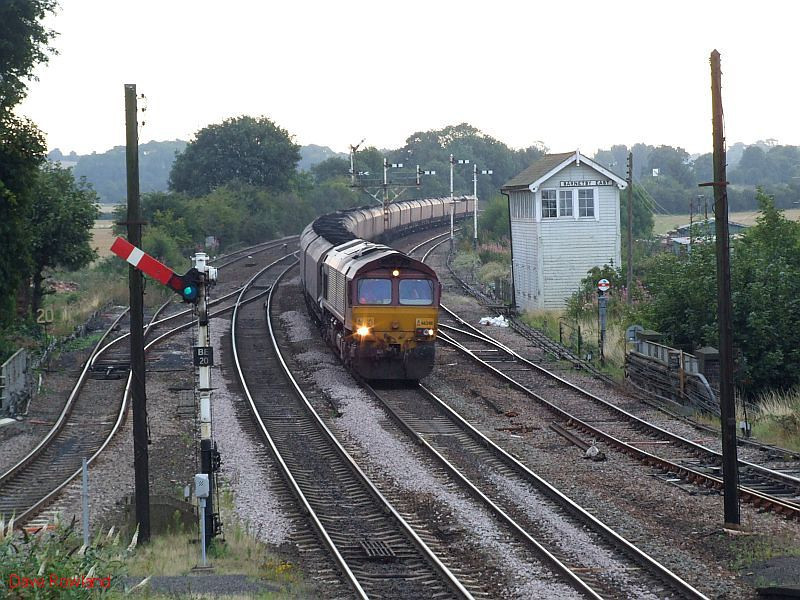 EWS 66248 passes Barnetby East signalbox with a westbound coal train. 20th August 2009.