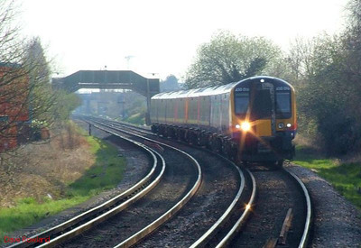 SWT 450 015 (leading) & 450 004 sprint towards Hilsea with 1P52, the 15.15 Portsmouth Harbour-Waterloo fast direct service (via Guildford). 19th March 2009.