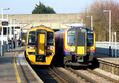 FGW 158 956 passes Hilsea with 1F26, the 15.22 Portsmouth Harbour-Cardiff Central, as SWT 450 109 pauses on the down with 2P39, the 13.45 Waterloo-Portsmouth Harbour (via Guildford) service. 19th March 2009.