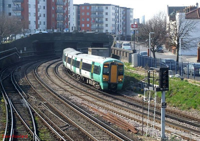 Southern Class 377/3 Electrostar 3-car EMU 377 318 approaches Fratton with 2N24, the 14.29 Portsmouth Harbour-Brighton service. 19th March 2009.