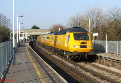 43014 leads the NMT south through Hilsea with 1X22. 19th March 2009.