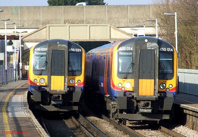 SWT 450 029 (left, trailing the unseen 450 085) passes Hilsea with 2P54, the 15.24 Portsmouth & Southsea-Waterloo (via Guildford) stopping service, while 450 014 (right) pauses with 2E41, the 14.44 Southampton Central-Portsmouth & Southsea stopper. 19th March 2009.