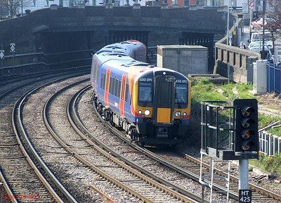 SWT 450 091 runs into Fratton with 2E44, the 14.38 Portsmouth & Southsea-Southampton Central stopper. 19th March 2009.