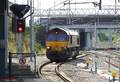 EWS 66142 runs light engine into Nuneaton heading towards Water Orton on Sunday 23rd August 2009.