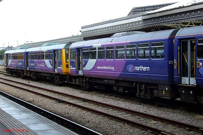 A fair number of DMUs can be found stabled at Sheffield on a Sunday; seen here on a centre road on the west side are Northern 142 066 (left) and 142 017. 23rd August 2009.