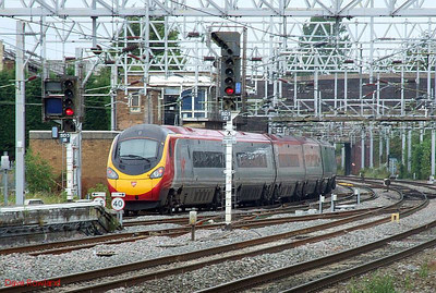 """Virgin Pendolino 390 047 """"Heaven's Angels"""" departs from Stafford at 09.23 with the 08.44 Birmingham New Street-Preston service on Sunday 23rd August 2009."""
