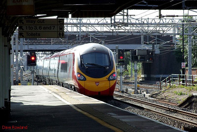 """VT Pendolino 390 006 """"Tate Liverpool"""" is seen again as it departs from Nuneaton at 09.54 with the 08.38 Liverpool Lime St-Euston service on Sunday 23rd August 2009."""