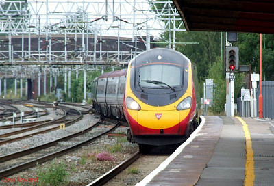"""VT Pendolino 390 006 """"Tate Liverpool"""" arrives at Stafford with the 08.38 Liverpool Lime St-Euston service on Sunday 23rd August 2009."""