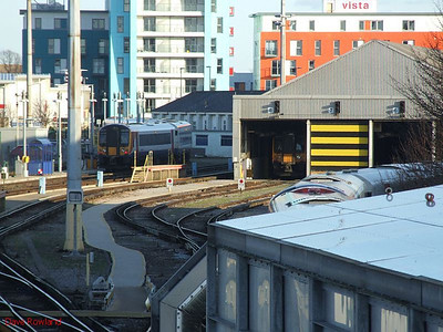 View of Fratton TMD from the cold footbridge; SWT 444 019 is the unit to the left of the depot. 30th January 2010.