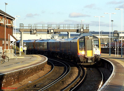 SWT 450 037 (with 450 025 behind) runs into Fratton with a Portsmouth & Southsea service on 30th January 2010.