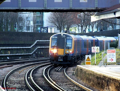SWT 450 028 runs into platform 1 at Fratton with 2E38, the 15.36 Portsmouth & Southsea-Southampton Central stopping service, on 30th January 2010.