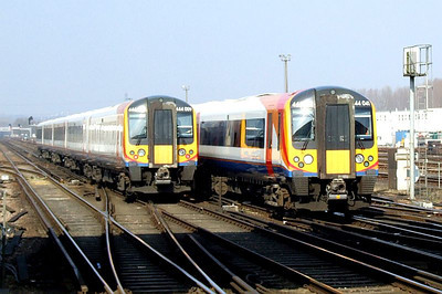 SWT 444 009, 1W18 12:03 Weymouth-Waterloo, and SWT 444 041, 1W25 12:35 Waterloo-Weymouth, Eastleigh, 8th March 2011.