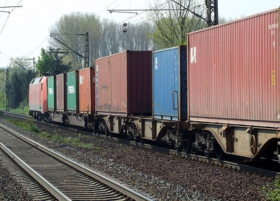 DB 152 150 passes Himmelstadt with a southbound container train on 20th April 2011.