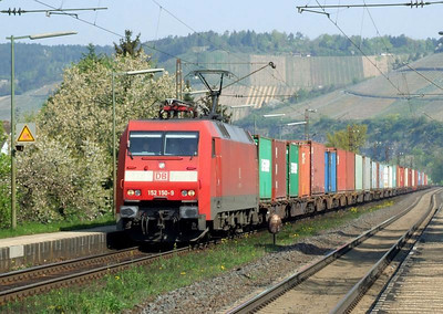 DB 152 150 is seen at Himmelstadt at the head of a southbound container train on 20th April 2011.