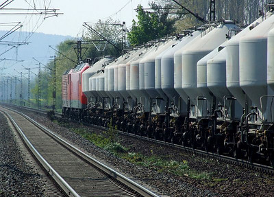 MEG 601 (ex-DB 143 179) & MEG 804 (ex-DB 156 004) pass south through Himmelstadt with a bulk cement train on 20th April 2011.