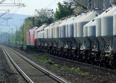 MEG 601 (ex-DB 143 179) & MEG 804 (ex-DB 156 004) pass south through Himmelstadt with a bulk cement train on 20th April 2011.