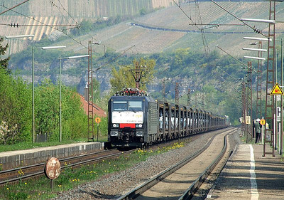 PCT ES 64 F4 035 (aka E 189 935 SE) heads south through Himmelstadt with a half-loaded car train on 20th April 2011.