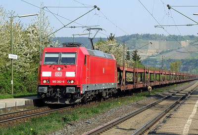 DB 185 382 hauls empty car wagons south through Himmelstadt on 20th April 2011.