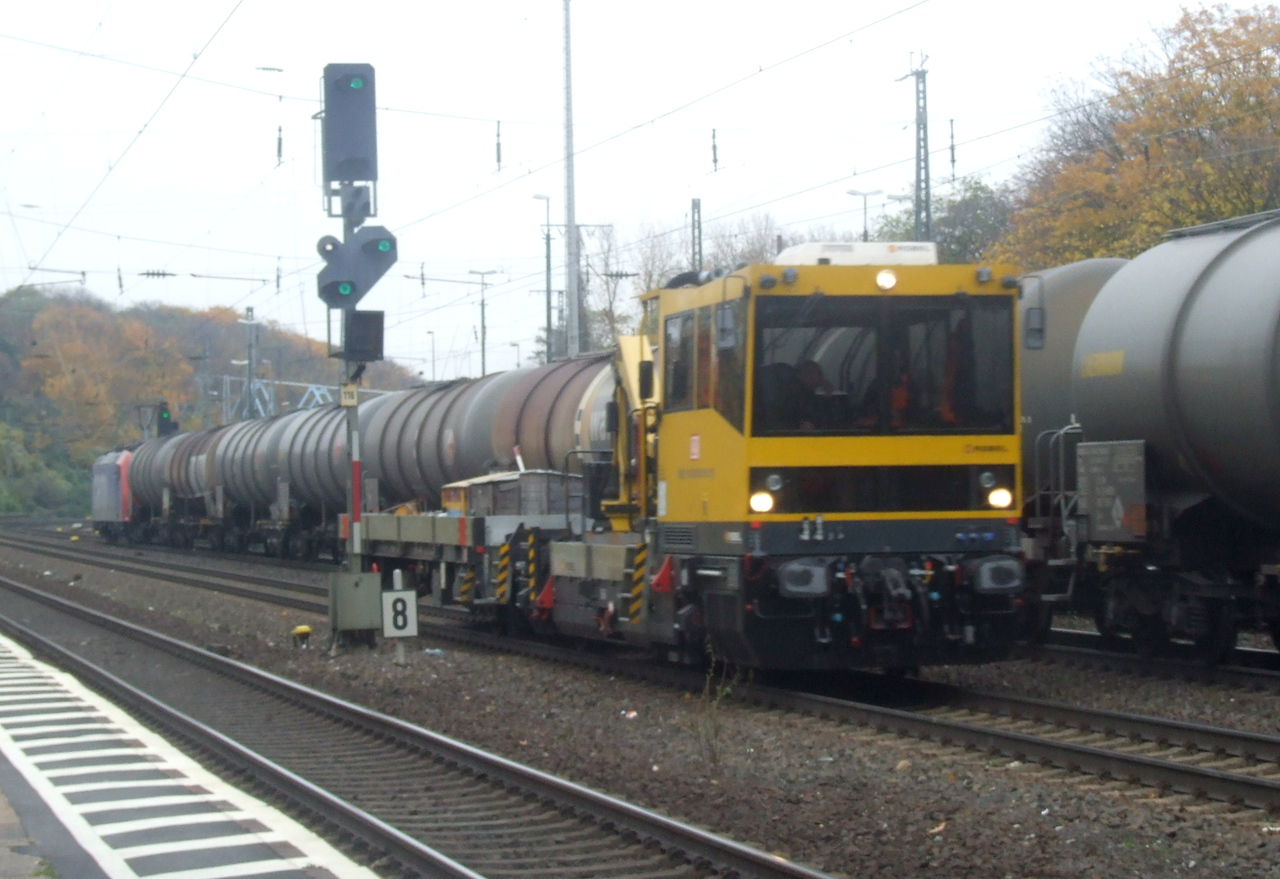 DB track machine and at Köln West, 13th November 2012. SBB Cargo 482 011
