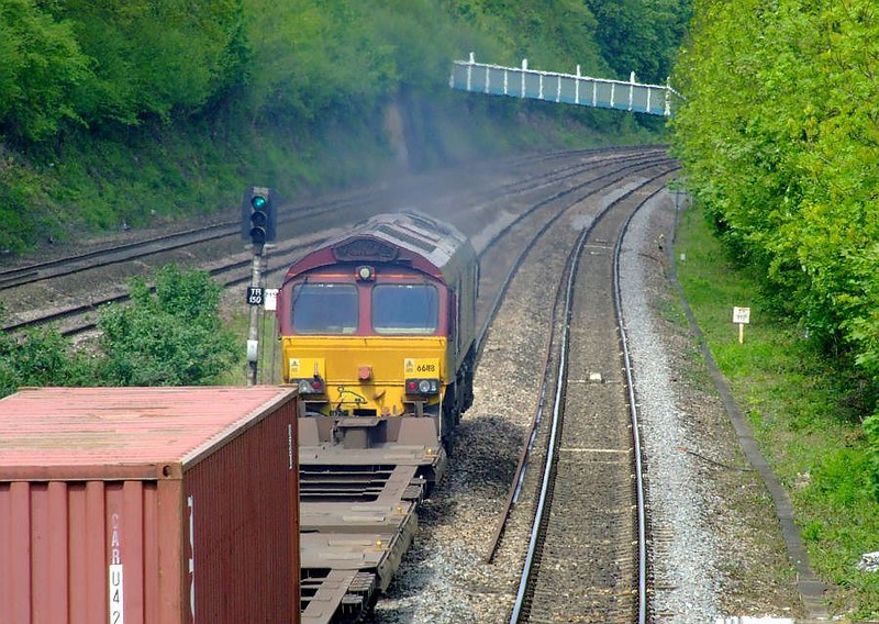 EWS 66118 passes Tilehurst with 4M66, the 09:32 Southampton Western Docks-Birch Coppice modal working on 15th May 2012.