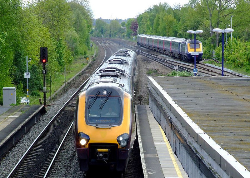 An XC Voyager and FGW HST speed through Tilehurst on the down relief/fast respectively. 15th May 2012.