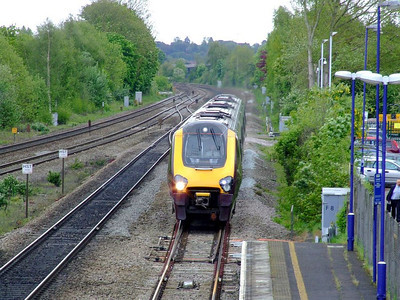 An unidentified XC Class 220 Voyager 4-car DEMU runs into Tilehurst on the down fast on 15th May 2012.