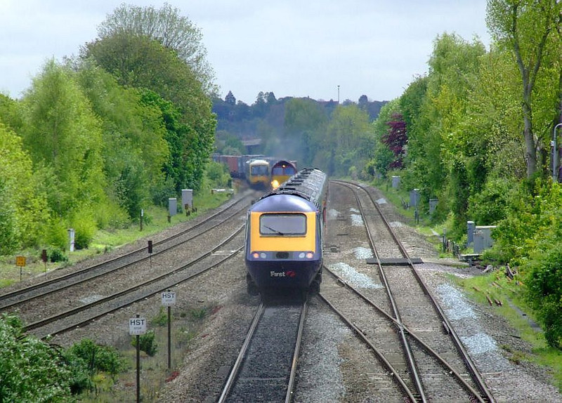 An unidentified FGW HST speeds past Tilehurst on the up fast on 15th May 2012; EWS 66118 and FGW 165 101 can also be seen.