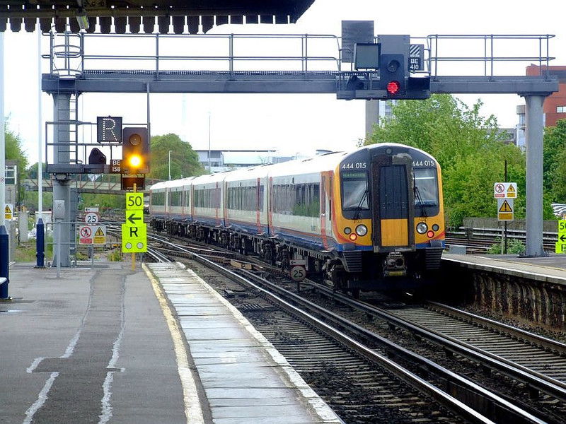 SWT 444 015 departs Basingstoke with a Waterloo service on 15th May 2012.