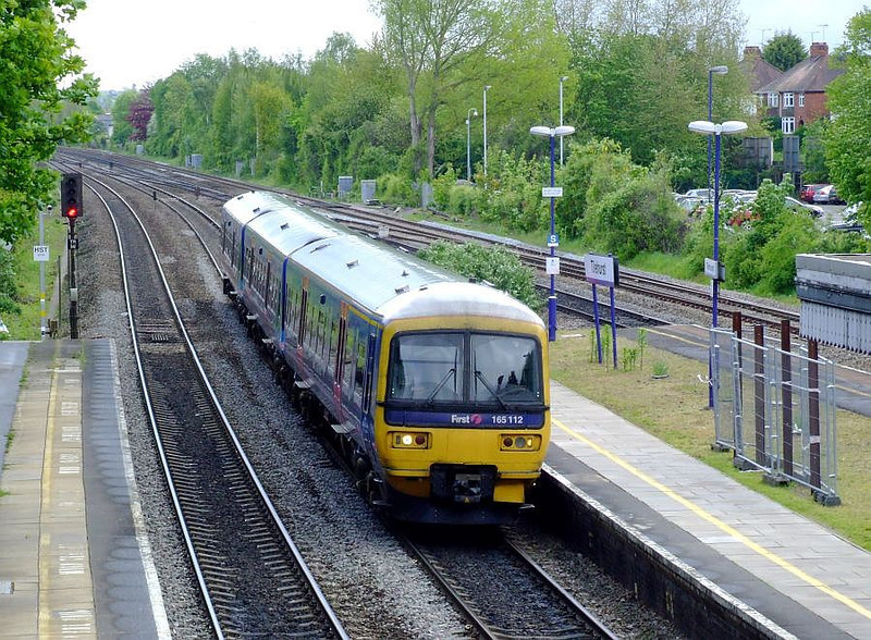 FGW 165 112 arrives at Tilehurst with a Paddington-Oxford stopping service on 15th May 2012.