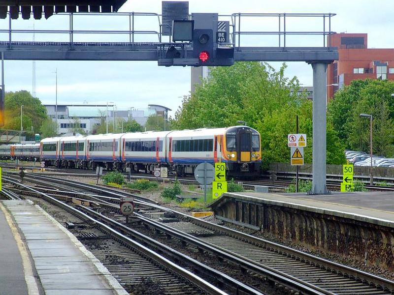 SWT 444 042 leaves Basingstoke with a Portsmouth Harbour-Waterloo working on 15th May 2012.