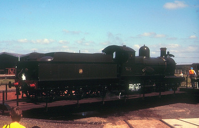 """'Dukedog' 4-4-0 3217 """"Earl of Berkeley"""" (ex-9017) on the turntable at Didcot GWS on 27th May 1989."""