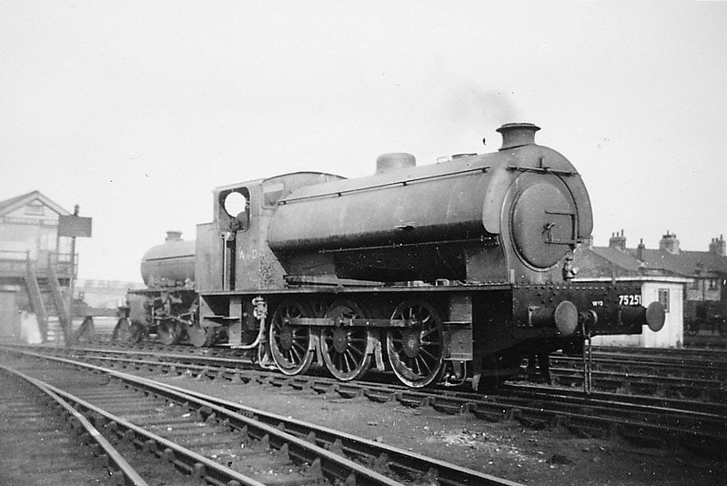 75251 - AUSTERITY 0-6-0ST - built 1945 by WG Bagnall & Co., Works No.2774 - seen here at Cambridge during WW2. <br /> Chosen by the War Department as it's standard shunting locomotive, The first Austerity 0-6-0ST was built in 1943 to a standard Hunslet Engine Co. design. Eventually, 485 engines were built by 6 different manufacturers and production did not end until 1964. After the War, examples remained all over Europe, 90 being retained for military use, 75 going to the LNER as Class J94, at least 36 ended up in Holland, many of the remainder going into industrial use, the newly formed NCB being a major customer. Around 70 are preserved in Britain with others in Europe.