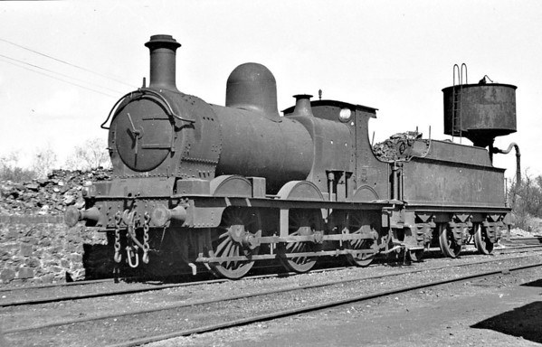 70197 - GWR 'Dean Goods' 0-6-0 - seen here at WD Kinnerley, 04/47. The caption says ex GWR No.1581 but this does not match up to any member of this class. In September 1946, there were no less than 11 members of this class present at Kinnerley, they being 70093 (ex-2433), 70094,  70095, 70096, 70098 (ex-2415), 70099, 70169, 70175, 70197, WD180 and GWR No.2442