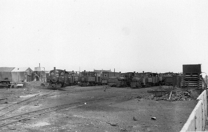 WD LOCO DUMP - 'Somewhere on the Western Front' - Baldwin or Alco locos on the left, 760mm gauge, and several locos similar to Talyllyn 'Douglas' on the right.